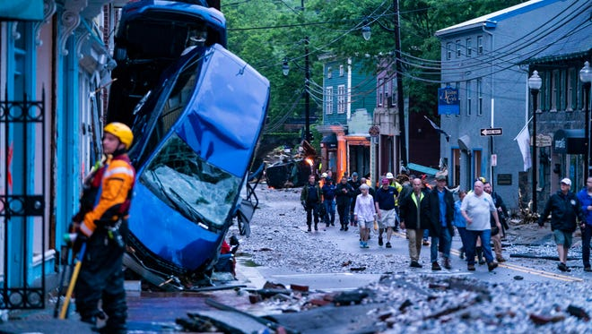 Rescue personnel examine damage on Main Street after a flash flood rushed through the historic town of Ellicott City, Maryland, on May 27, 2018.