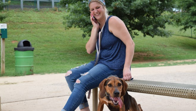 Brooke Taylor poses with her pure bred coon hound Layla Jane at the Concord Dog Park. Experts say that in the summertime, try limiting dog walks to the earlier or later hours of the day when the heat is less intense.