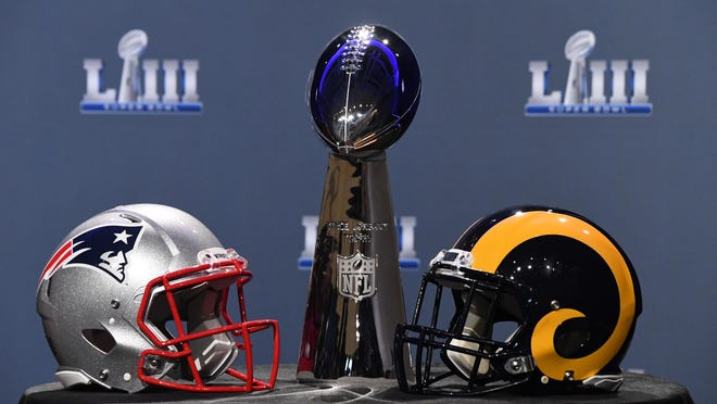 Jan 30, 2019; Atlanta, GA, USA; The Vince Lombardi Trophy and helmets for the New England Patriots and Los Angeles Rams are displayed before the Roger Goodell press conference in advance of Super Bowl LIII at Georgia World Congress Center. Mandatory Credit: Kirby Lee-USA TODAY Sports