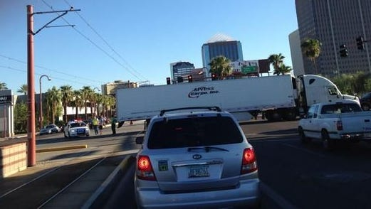 A truck stuck on the light rail tracks caused minor delays in central Phoenix on Wednesday afternoon.