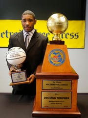 2014 Michigan Mr. Basketball DeShaun Thrower with his personal trophy and the main trophy during the announcement for his award at the Detroit Free Press in Detroit on March 17, 2014.