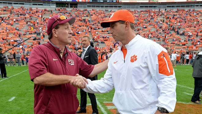 Clemson head coach Dabo Swinney meets with Florida State head coach Jimbo Fisher during pre-game of Clemson's game against Florida State Saturday, November 7, 2015 at Clemson's Memorial Stadium.