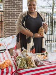Kaneisha Scott represents KB Popcorn during the Gallatin Farmers Market last year.