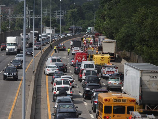 Southbound traffic on I-95 is stopped as firefighters extinguish a truck fire south of the Chatsworth Avenue Bridge in Larchmont, July 15, 2014.