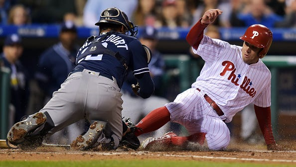 Phillies' Peter Bourjos gets tagged at home in the fourth inning Wednesday by the Padres' Christian Bethancourt at Citizens Bank Park. Bourjos reached on an error.