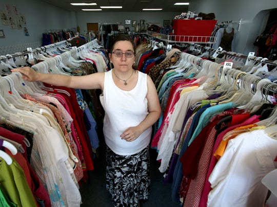 Nicole Doom inside her clothing resale shop called