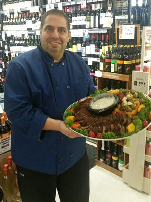 Chef Carl Hakim of Johnny Pomodoro's Fresh Market in Farmington Hills with a Cooked Beef Tenderloin appetizer.
