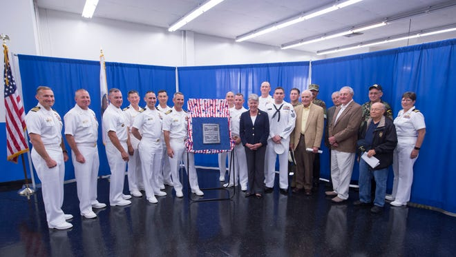 "U.S. Rep. Julia Brownley and local Seabee leadership and veterans stand with a plaque naming the Port Hueneme post office in honor of U.S. Naval Construction Battalion ""Seabees"" Fallen Heroes, during a ceremony May 31."