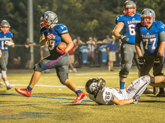 Senior running back Ty Snelson plows over a North Buncombe