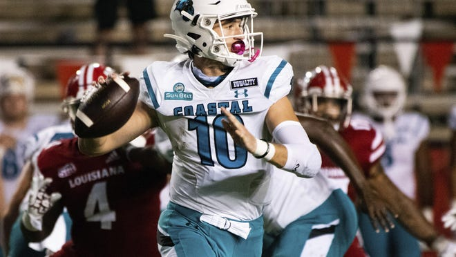 Coastal Carolina quarterback Grayson McCall (10) looks to pass during the 30-27 victory over then-No. 21 Louisiana in Lafayette, La., on Oct. 14.
