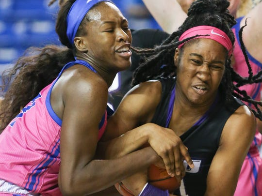 Delaware's Nicole Enabosi (left) grabs for a rebound against James Madison's Kayla Cooper-Williams in the first half at the Bob Carpenter Center Friday.