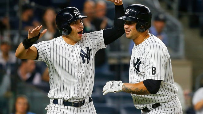 NEW YORK, NY - SEPTEMBER 27:  Gary Sanchez #24 of the New York Yankees celebrates his first inning two-run home run against the Boston Red Sox with teammate Jacoby Ellsbury #22 at Yankee Stadium on September 27, 2016 in the Bronx borough of New York City.  (Photo by Jim McIsaac/Getty Images) ORG XMIT: 607685701 ORIG FILE ID: 610739856