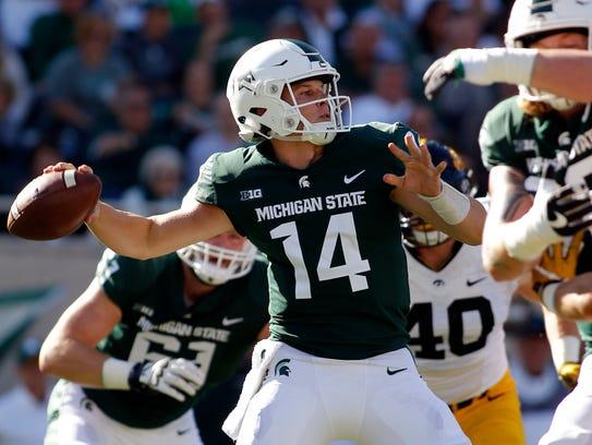 Michigan State quarterback Brian Lewerke throws a pass