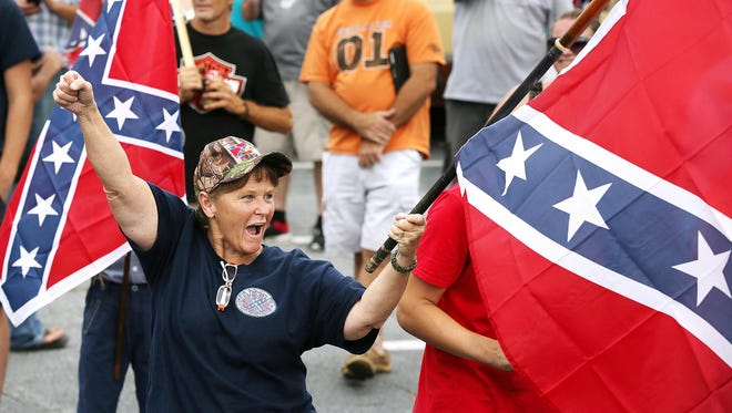 Betty Bishop, of Temple, Ga., waves her flag during a pro-Confederate flag rally at Stone Mountain Park in Stone Mountain, Ga., on Saturday.