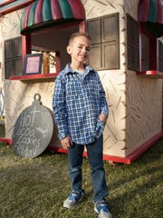 Cooper Camp, an 8-year-old Santa Clara resident, sells