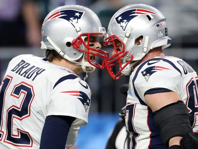 New England Patriots quarterback Tom Brady (12) and