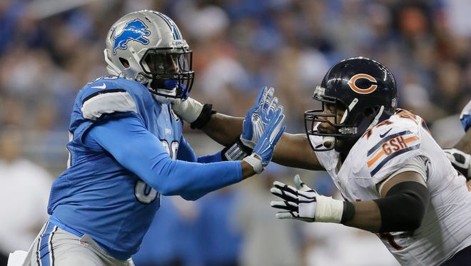Detroit Lions defensive end George Johnson, left, plays against the Chicago Bears on Nov. 27, 2014.