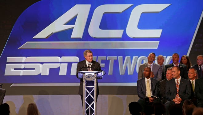 Commissioner John Swofford, center, announces an ACC/ESPN Network during a news conference at the Atlantic Coast Conference Football Kickoff in Charlotte, N.C., Thursday, July 21, 2016.