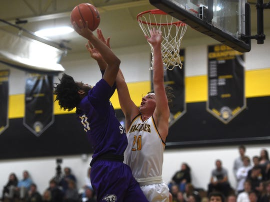 Spanish Springs' Dante Craig shoots over Galena's Trae Thomson during their basketball game in Reno on Dec. 15, 2017.