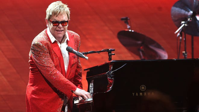 Musician Elton John performs at the Barclays Center on December 31, 2014 in the Brooklyn borough of New York City. This was the first time he has performed in New York City on a New Year's Eve.