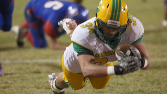 Coachella running back Romeo Martinez dives into the end zone for the first score during Coachella's win, Friday, November 6, 2015