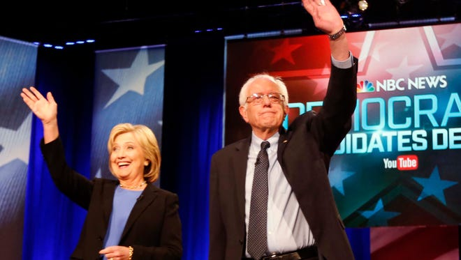 In this Jan. 17, 2016 photo, Democratic presidential candidates, Hillary Clinton and Sen. Bernie Sanders, stand together before the start of the NBC, YouTube Democratic presidential debate at the Gaillard Center in Charleston, S.C.