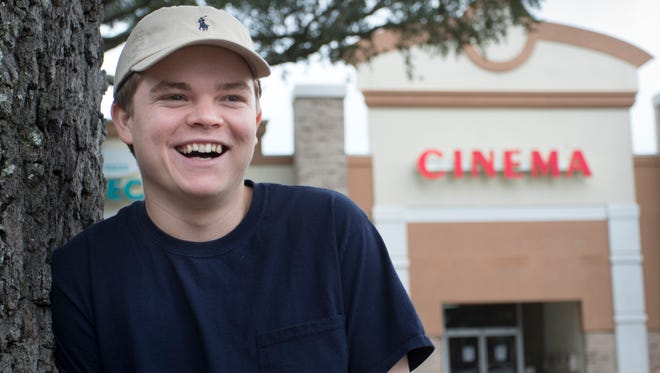 Clay Bloodworth, a 2016 Gulf Breeze High School graduate and student filmmaker, poses outside of the Tree House Cinema where he has worked in various roles in Gulf Breeze. Bloodworth's short film 'Newsman' will be entered in a film festival in Windsor, Calif. in January.