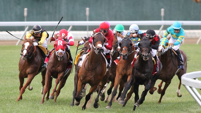Bigger Picture (right rear), under jockey Joe Bravo, begins his move to win the Grade I $300,000 United Nations Stakes Saturday at Monmouth Park. State officials are investigating whether Monmouth Park would be forced to close this weekend due to the state shutdown.