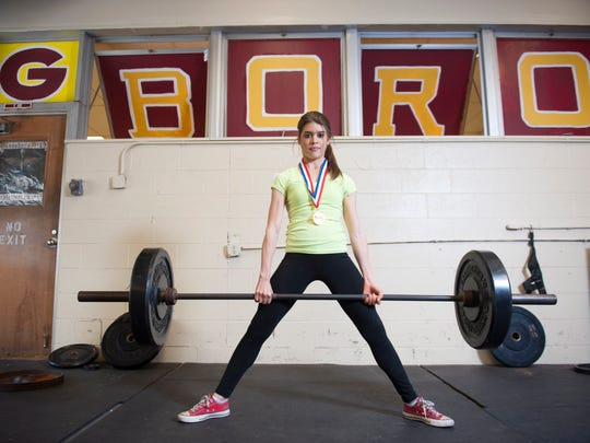 Glassboro H. S. junior and powerlifter Colleen Grehlinger works out in the weight room at Glassboro High School. Thursday, January 28, 2016.