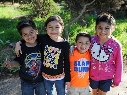 From left, Matthew and Kamyla Cruz Mendoza, with Adan and Cierra Espinoza in Salinas' Natividad Creek Park.