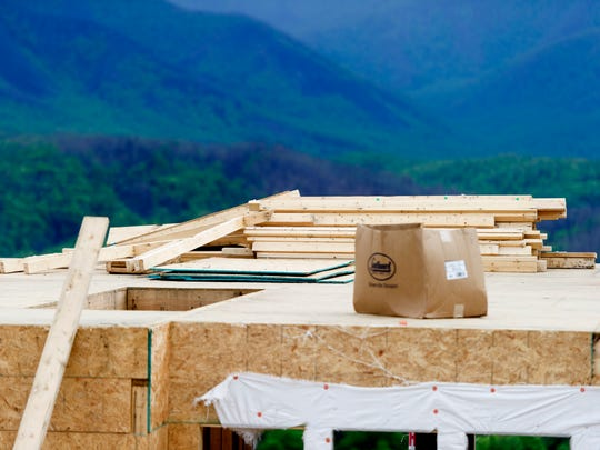 Building supplies sit on the upper level of Glenn Warren's new home on Wiley-Oakley Drive in Gatlinburg, Tennessee on Friday, May 5, 2017. Warren had lost his home in the November wildfires and the roof of his new home under construction due to strong winds yesterday.