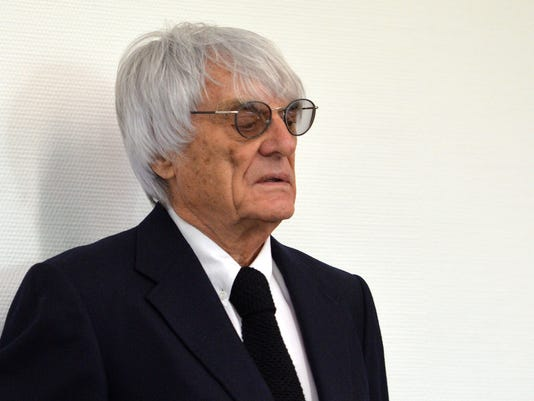 """Formula One boss Bernie Ecclestone waits in the court in Munich , southern Germany,  Tuesday, July 1, 2014. Ecclestone is charged with bribery and incitement to breach of trust """"in an especially grave case"""" over a US $44 million payment to a German banker, that prosecutors allege was meant to facilitate the sale of the Formula One Group to a buyer of Ecclestone's liking. (AP Photo/Kerstin Joensson,Pool)"""