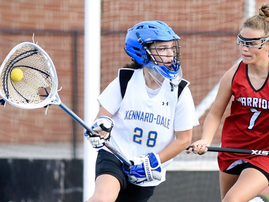 Kennard-Dale goalie Maria Schneider, left, looks to pass the ball away from Susquehannock's Kenna Hancock during PIAA Class 2-A girls' lacrosse state semifinal action at Papermaker Stadium in Spring Grove, Tuesday, June 6, 2017. Scheider returns this year for the Rams. YORK DISPATCH FILE PHOTO