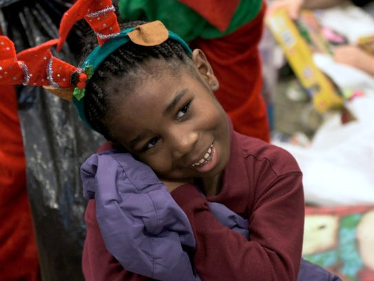 Aaliyah Randolph, 6, holds her new jacket Wednesday,