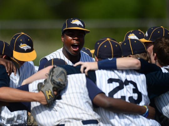 Chincoteague's Jaquan Persinger, center, gets his teammates fired up bfore they take the field for the Region 1-A East Regional quarterfinal game against Middlesex.