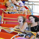 Ryann Malsbury, 13, left, and Brooke Wagner, 13, both of Somers, Westchester County, enjoy a ride at the Dutchess County Fair in 2014.