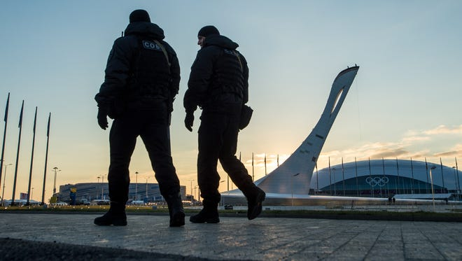 Police providing security for the Winter Games patrol Olympic Park prior to 2014 Sochi Winter Olympic Games.