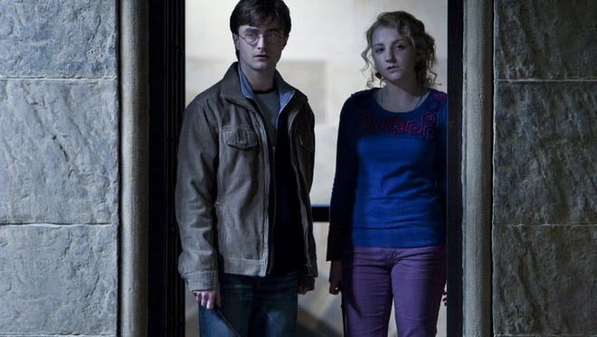 """Daniel Radcliffe and Evanna Lynch in a scene from """"Harry Potter and the Deathly Hallows: Part 2."""""""