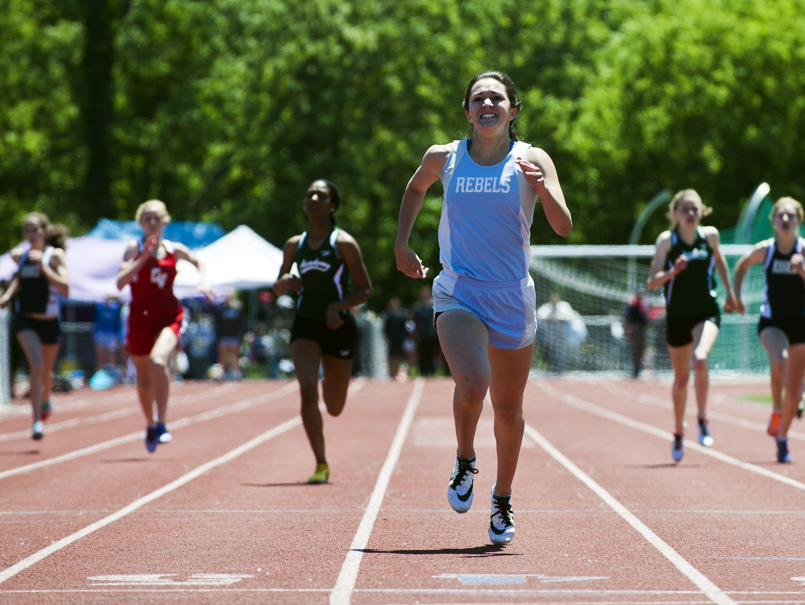 South Burlington's Kayla Gilding competes in the 100m dash during the high school track and field state championship meet at Burlington High School on Saturday June 6, 2015 in Burlington, Vermont.