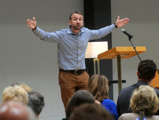 Jonathan Storment talks about Jesus' crucifixion to the crowd at the annual Holy Week luncheon at First Baptist Church Family Life Center in April 2017.