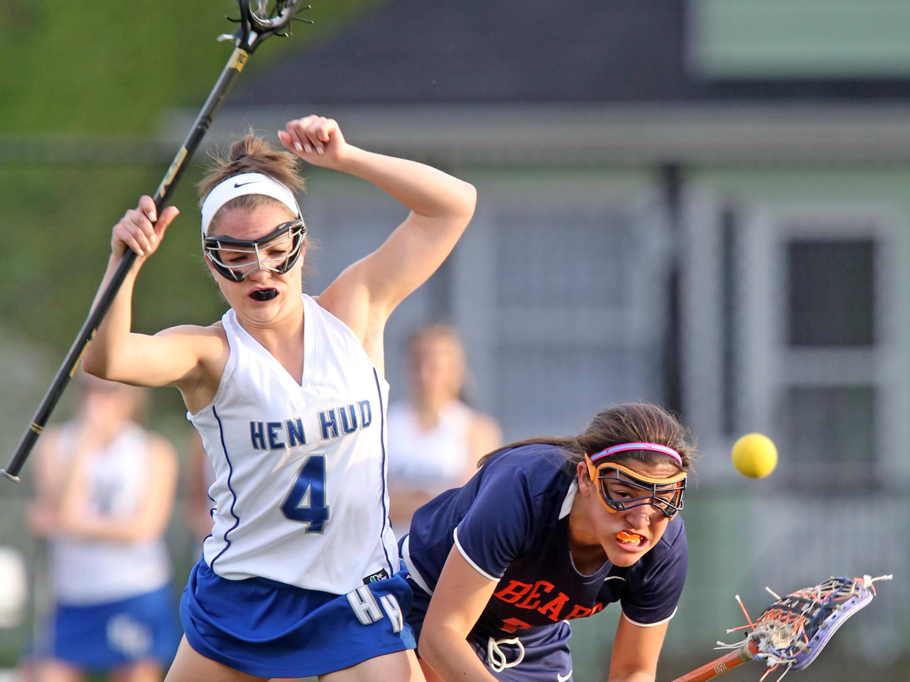 Briarcliff's Lexi Grasso, right, and Hen Hud's Montana Garrett battle for ball control during Wednesday's girls lacrosse game at Hendrick Hudson High School in Montrose. The Sailors won 11-10.