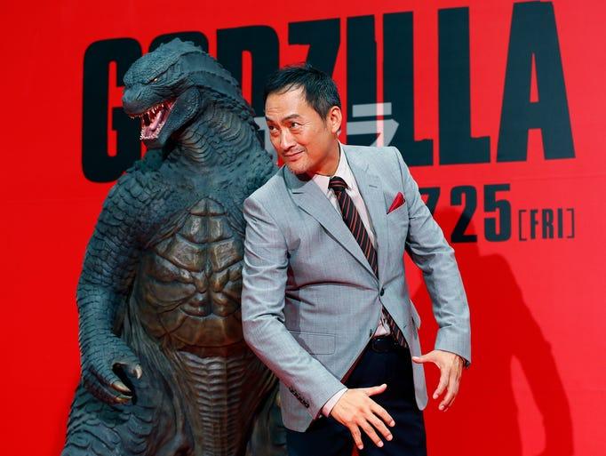 "Japanese actor Ken Watanabe poses for photographers during the Japan premiere of his movie ""Godzilla"" in Tokyo, Thursday, July 10, 2014. (AP Photo/Shizuo Kambayashi)"