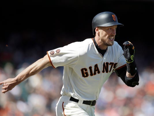 San Francisco Giants' Hunter Pence grimaces as he runs to first base on a a ground out during the eighth inning of a baseball game against the Arizona Diamondbacks on Thursday, April 21, 2016, in San Francisco. Arizona won 6-2. (AP Photo/Marcio Jose Sanchez)