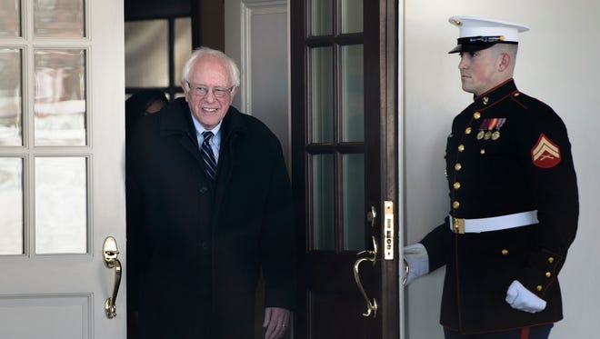 Democratic presidential candidate Sen. Bernie Senator I-Vt.,,  leaves the West Wing of the White House after a meeting with President Obama Wednesday.
