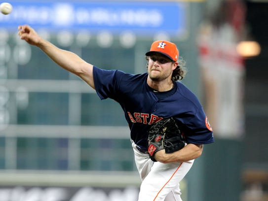 Astros starter Gerrit Cole fires a pitch against the