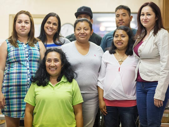 Graduates and teachers of a parenting program at the Redlands Christian Migrant Association in Bonita Springs capture the moment recently at the center.
