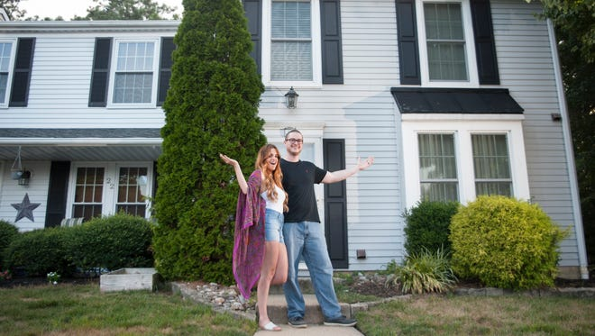 Amanda and Evan Longmore stand in front of their Marlton home.  The couple filmed an episode of the HGTV show 'House Hunters' in February and March. The show shows buyers from all over the country as they search for a home.  The episode the couple will appear on is scheduled to air on Aug. 7 at 10 p.m. and is entitled 'Making a Move to Marlton.'