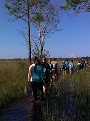 College students hike during one of CREW's educational programs.