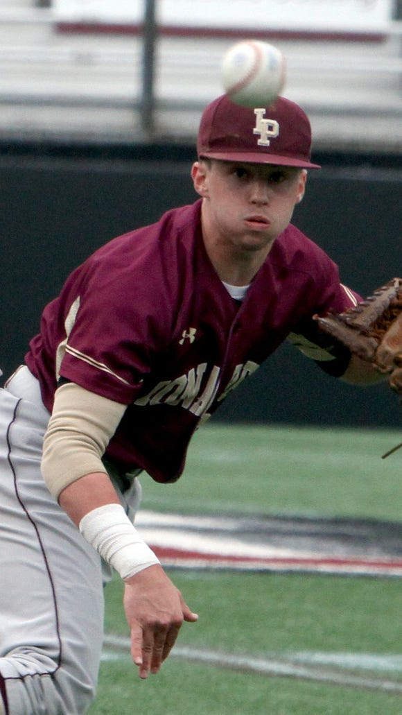Iona Prep shortstop Michael Gordon completes a double