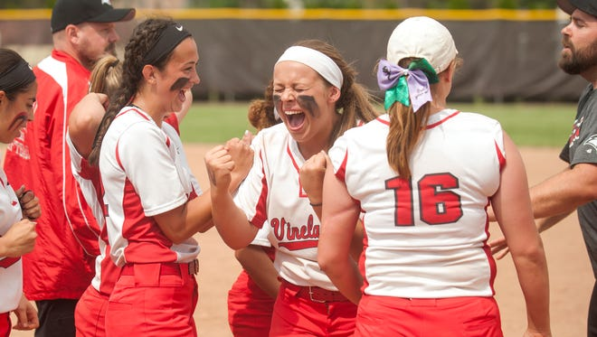 Devin Coia, center, celebrates with Vineland softball teammates after the Fighting Clan down Montgomery in the Group 4 semifinal on May 31.
